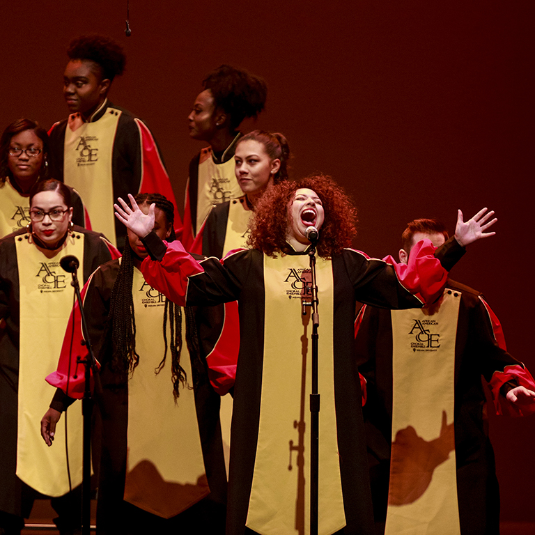African American Choral Ensemble vocalist performing on stage