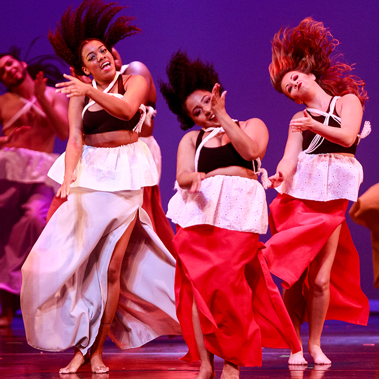 Dancers onstage with the African American Dance Company