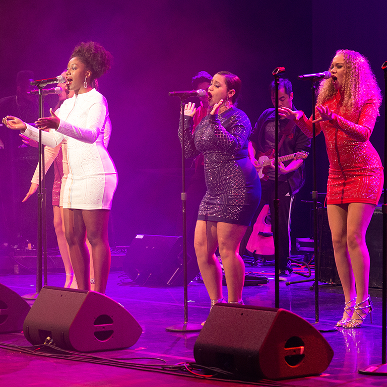 A group of female singers performs with the IU Soul Revue