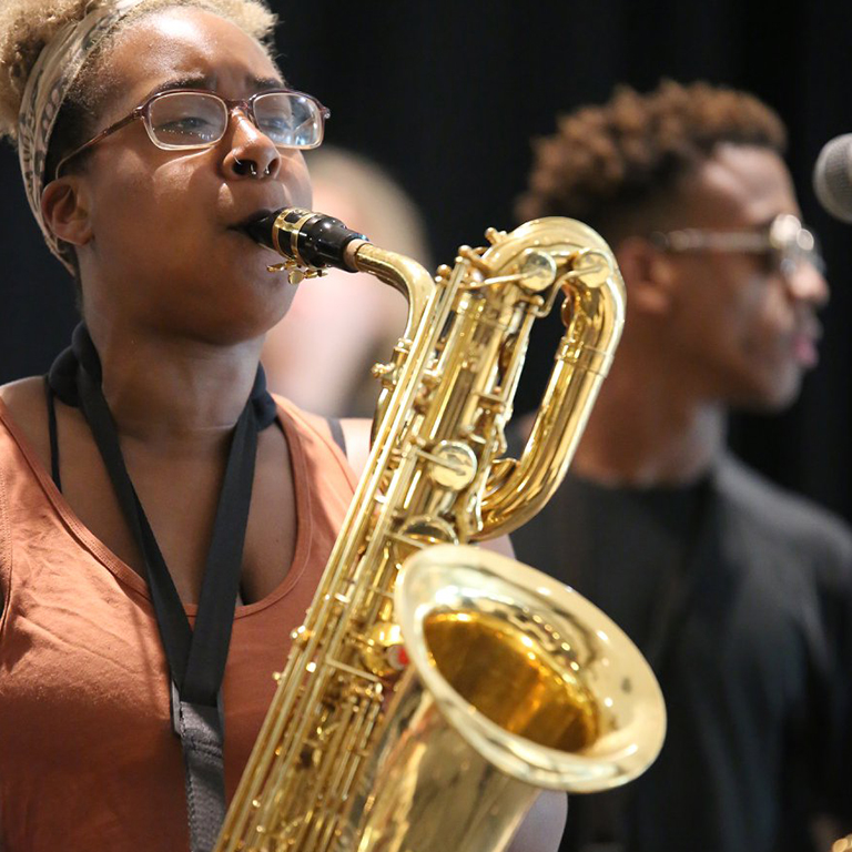 A student plays saxophone during a Camp S.O.U.L. rehearsal