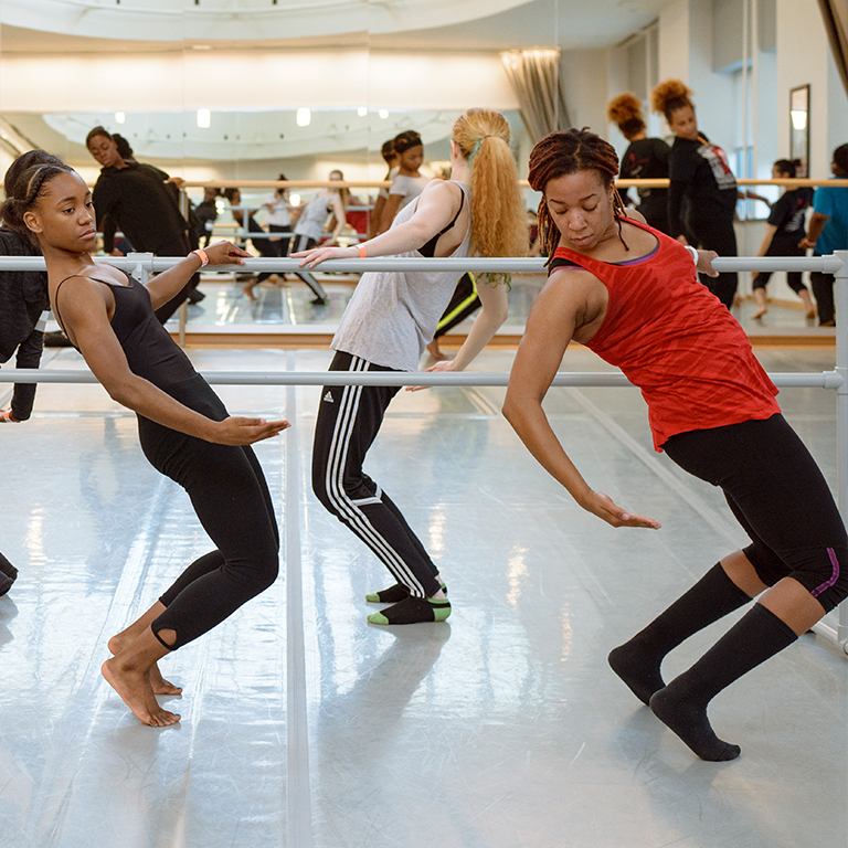 Dancers rehearsing in the studio during the African American Dance Company Workshop